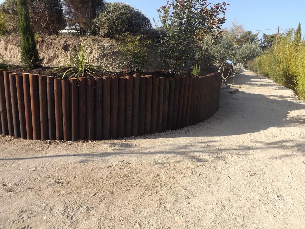Mur de soutnement en bois portfolio with mur de for Mur en bois pour jardin